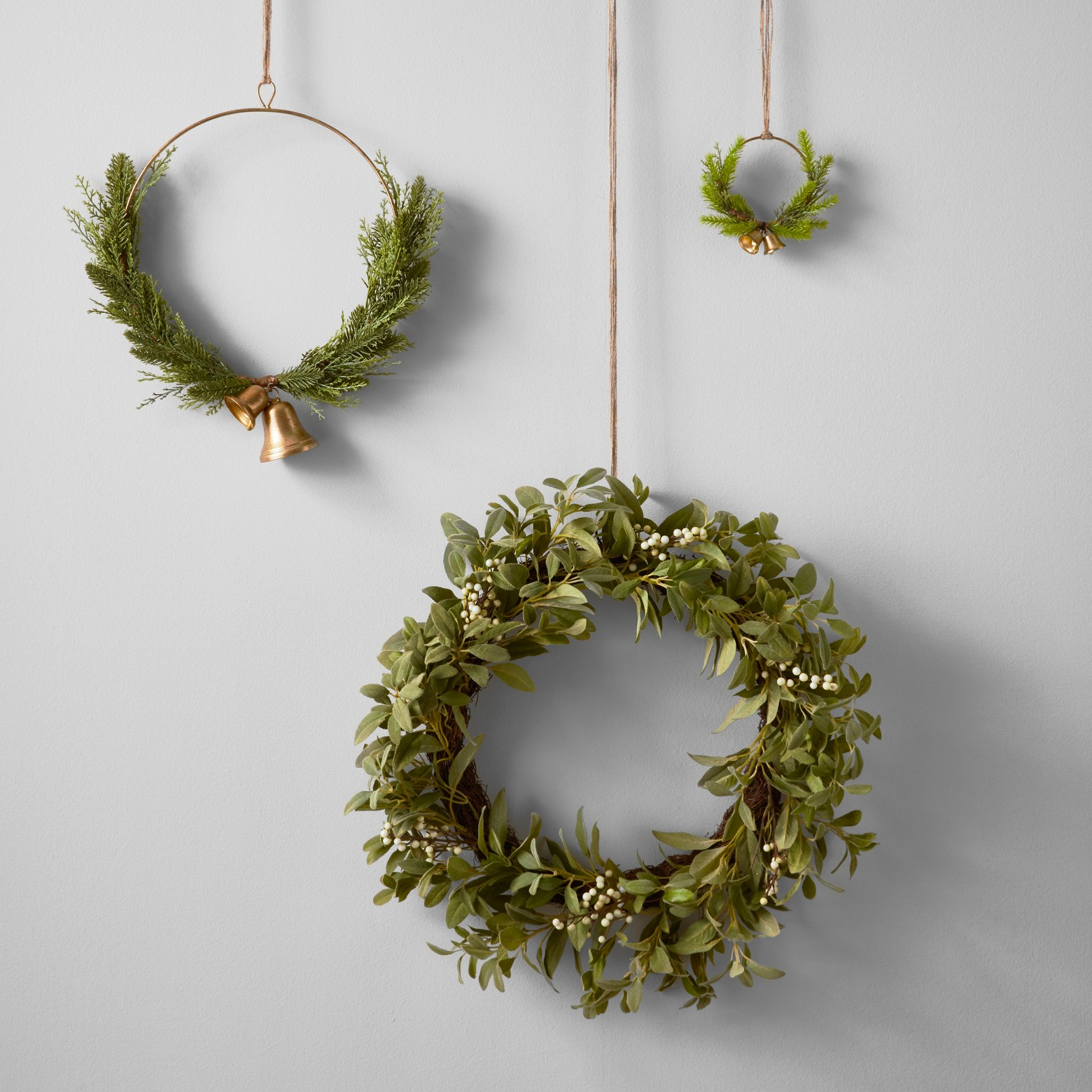 Wreath - Getting into the Christmas spirit a little early is never a bad thing! These dainty artificial wreaths are great for the holiday season. Hang the assorted sizes together, or accent your doors with these sweet foliage wreaths.