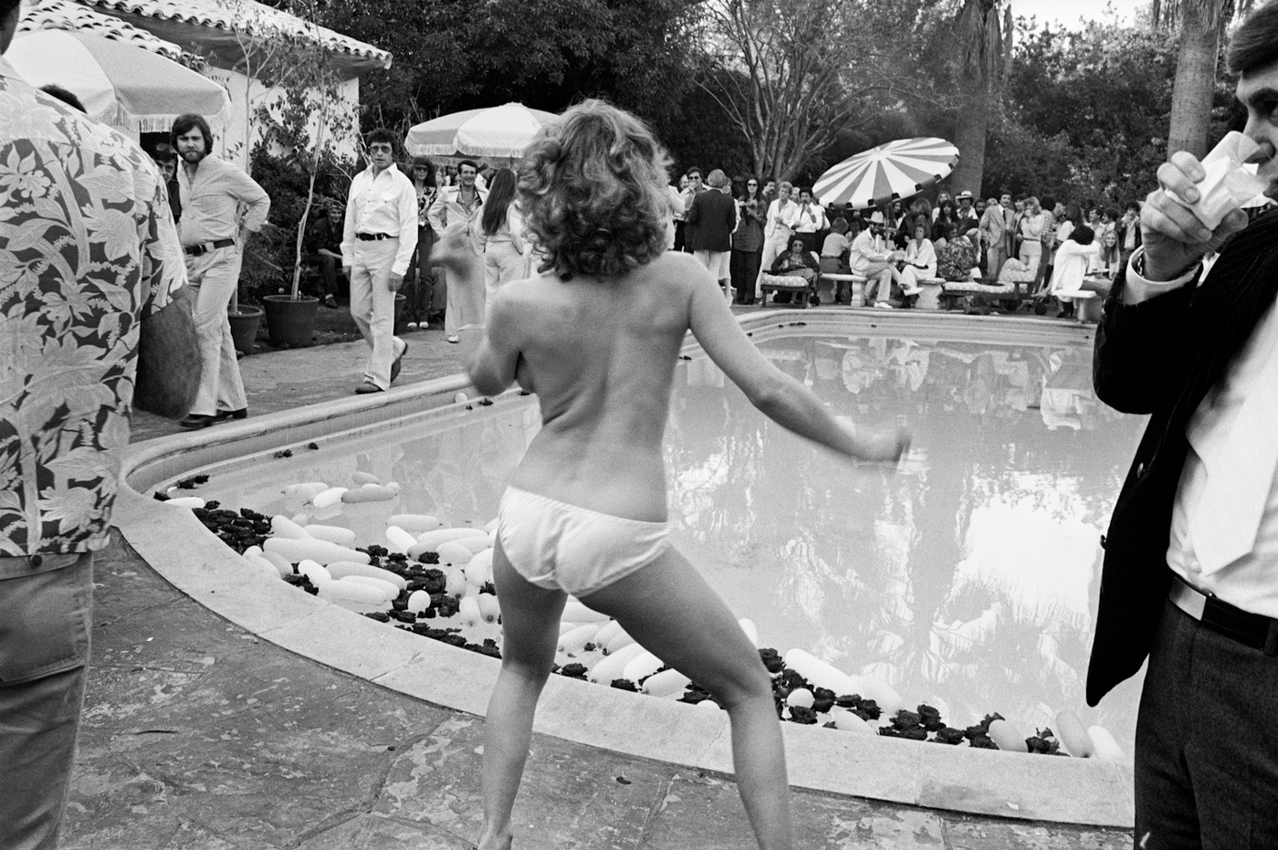 A Beverly Hills Party To Remember,1977 - I think John Rockwell invited me to this party. It took place at a large mansion directly behind The Beverly Hills Hotel. I was the youngest guest. Not even old enough to drink. Right before I spilt, this girl came out in front of me and took off her clothes and started to dance. Look closely at the guy on the left walking over to the girl, that is Burt the party crasher. He was legendary and never missed a party!