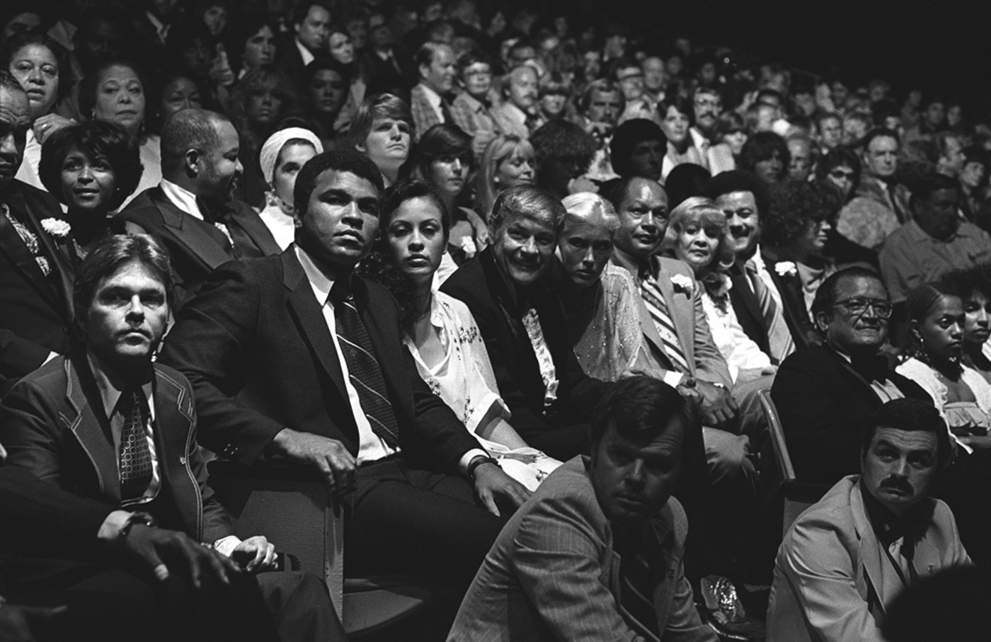 Muhammad Ali: KING ALI, 1979 - Muhammad Ali was the most recognizable human being on the planet earth. When he sat down in his seat at the Forum for this charity gig, all 18,400 people stood up to applaud him. I love the way he looks like a king in this photo. Seated with him is his wife Veronica, Jerry Buss, Mayor Bradley and his wife Ethel and Former Commerce Secretary Ron Brown.