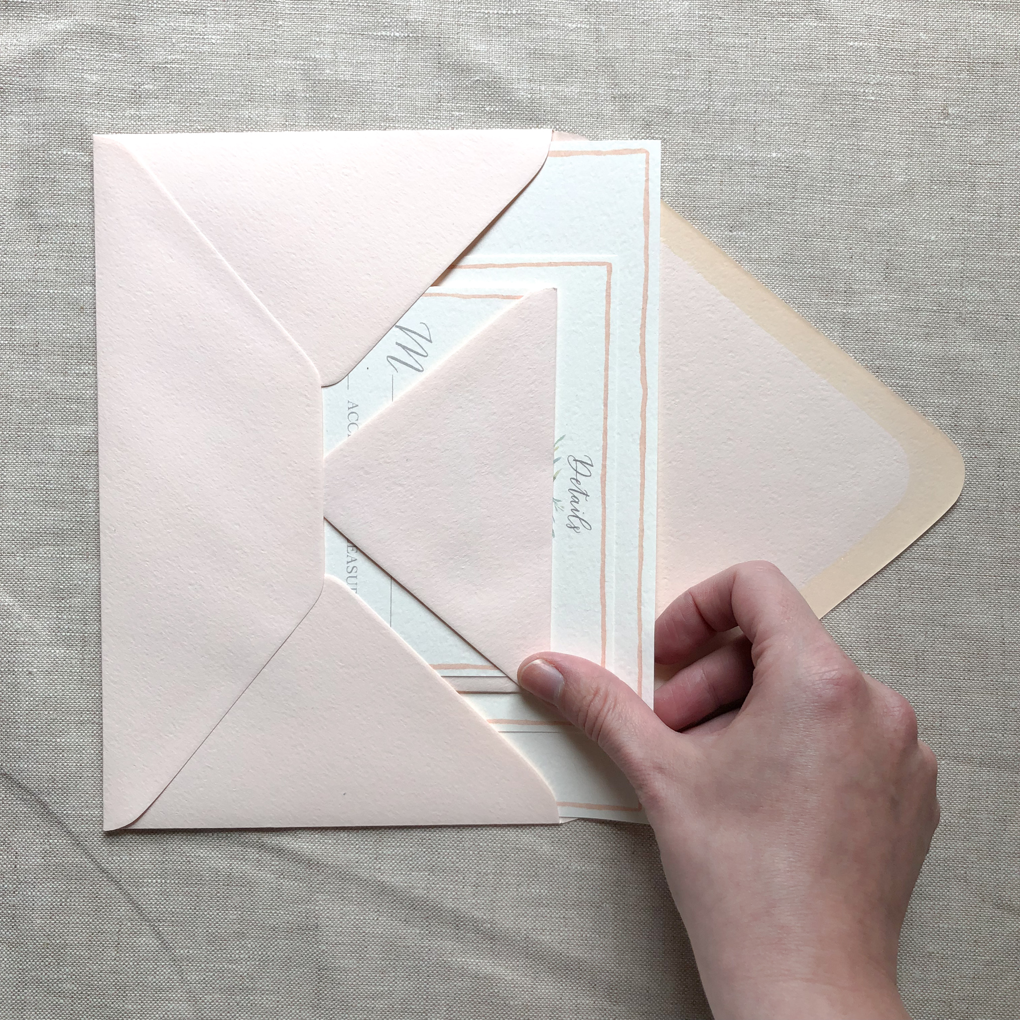 An example of a wedding suite containing a response card and envelope, details card, and invitation.