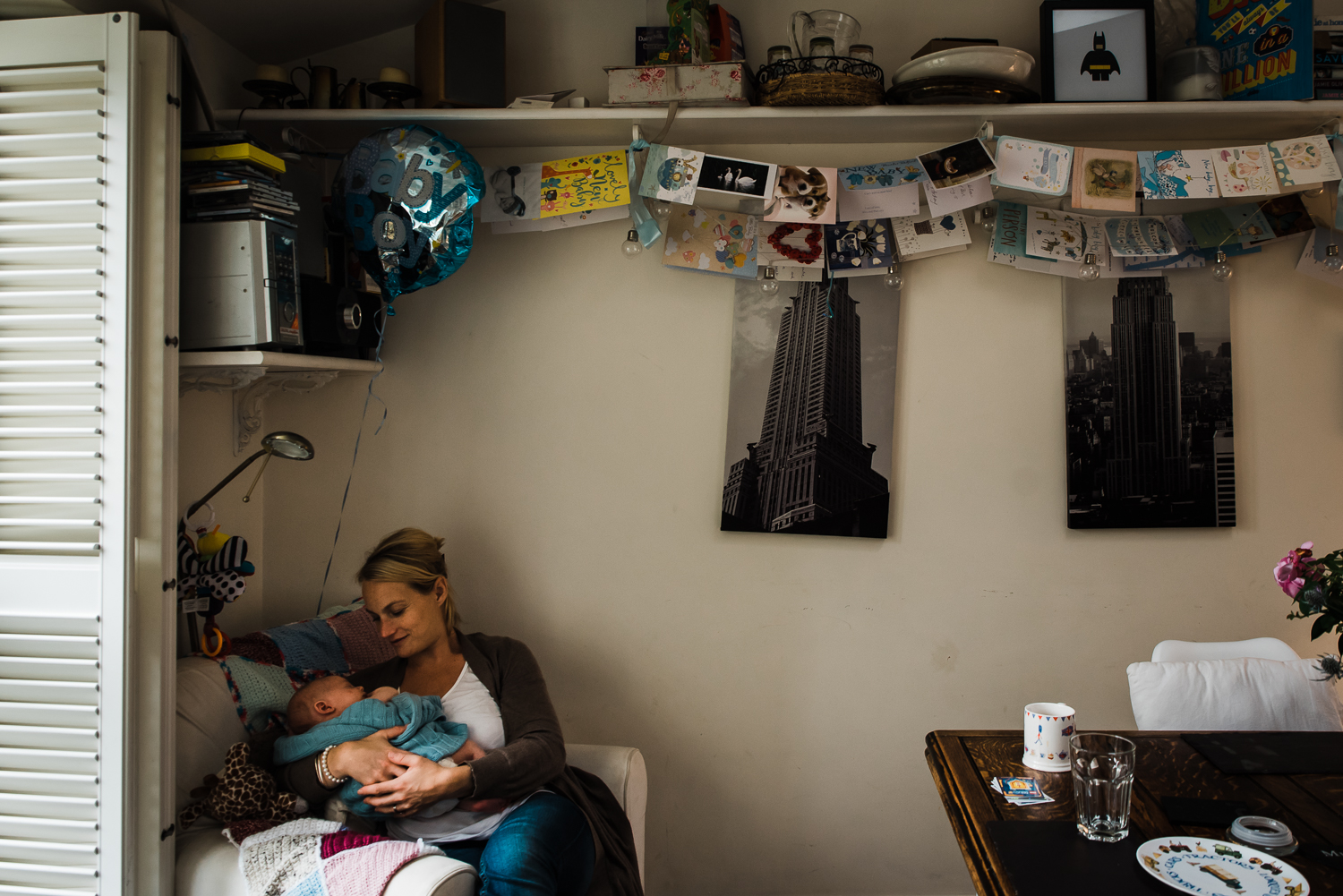 Quiet corner in kitchen cradling baby - in-home documentary shoot with Diana Hagues Photography