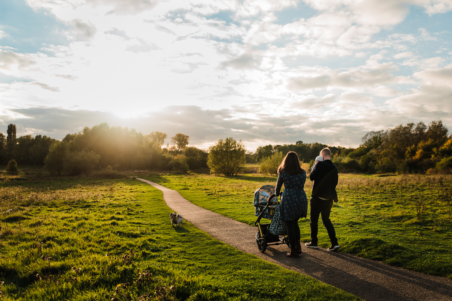 Walking into the sunset on a newborn photo session in Huntingdon