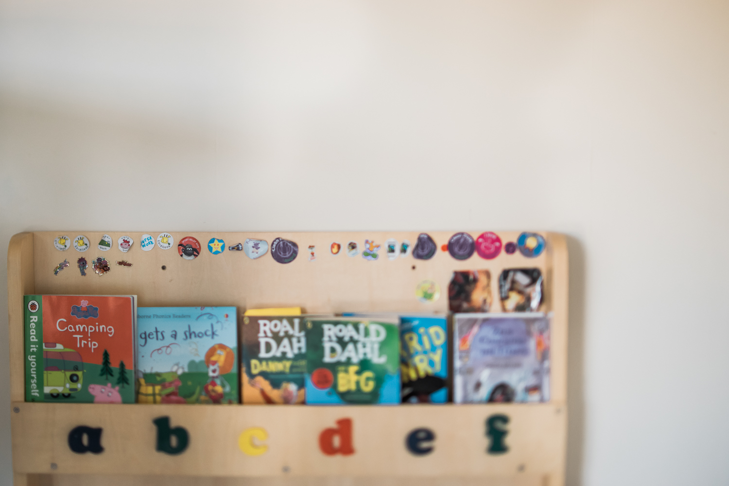 sticker collection on child bookcase