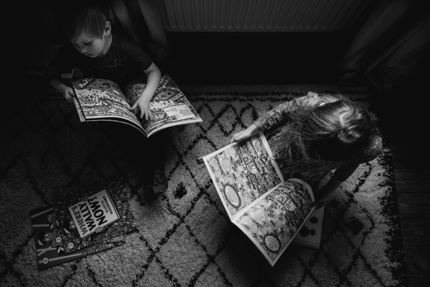 children reading books on the carpet black and white photograph