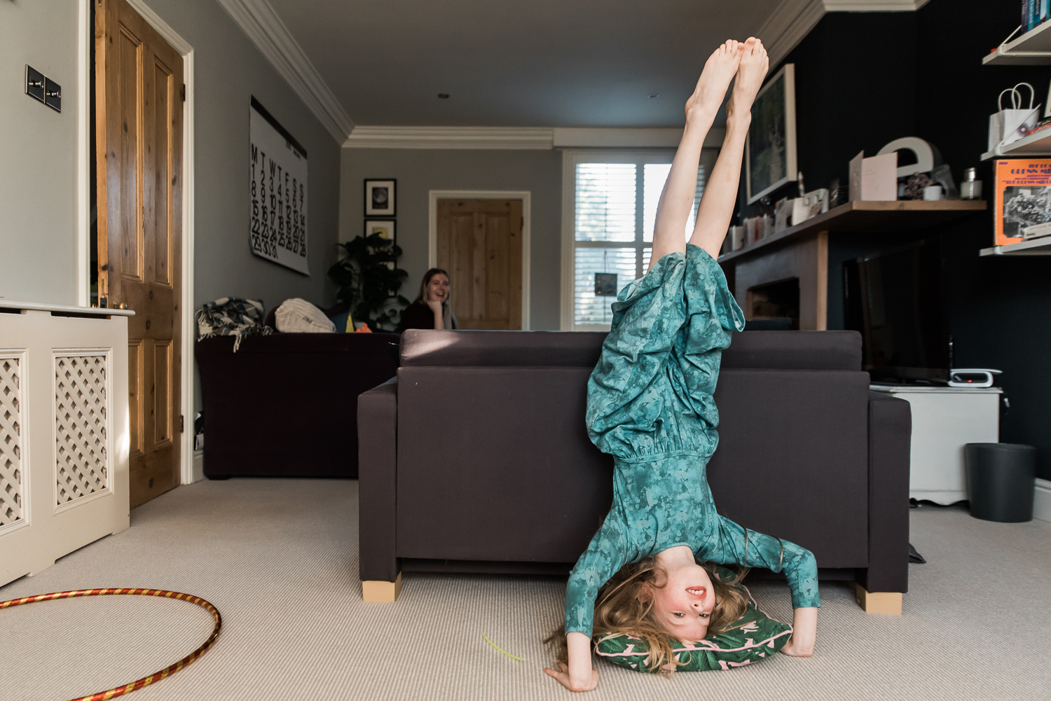 girl headstand in-home family photoshoot green dress Diana Hagues Photography