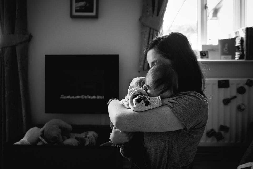 mother soothing her baby black and white photography