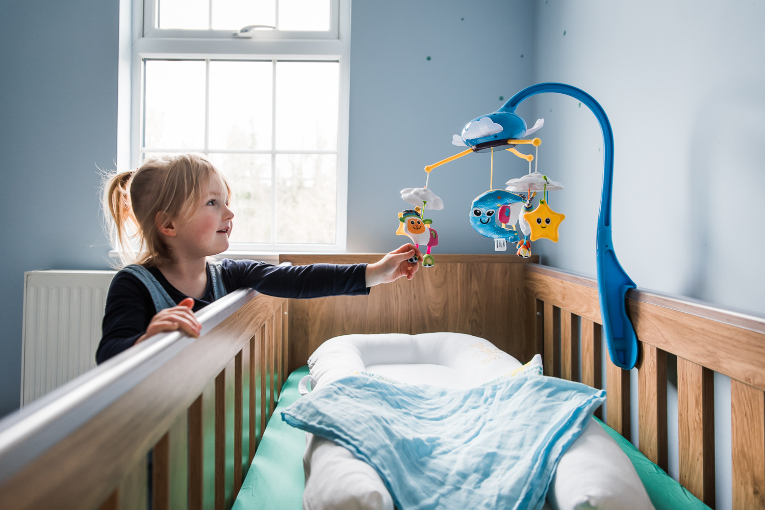 Baby mobile on the cot in the nursery