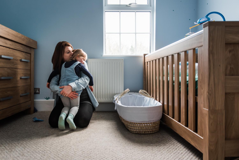 Cuddles in the baby nursery