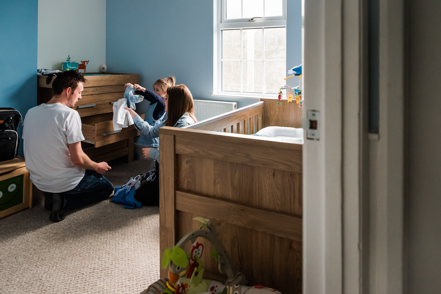 Family in the baby nursery