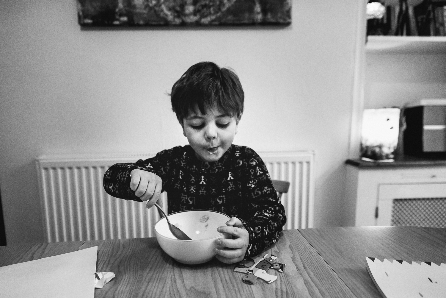 Copy of Breakfast scene boy eating his bowl of cereal with milk moustach