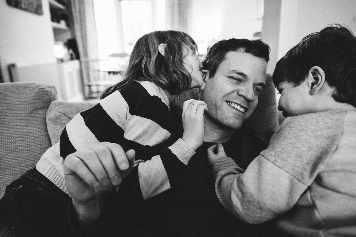 Copy of dad and his two children share a tender moment together - Diana