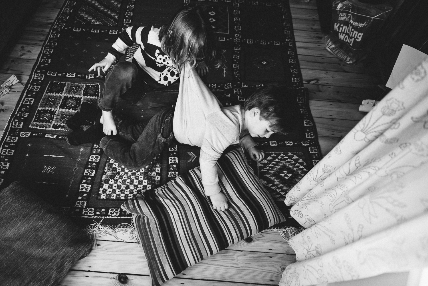 Copy of two siblings having a playfight in their home -Diana Hagues Phot