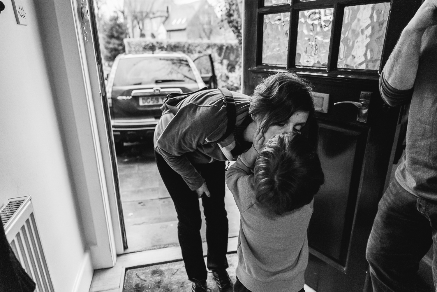 Copy of Son giving his mother a kiss goodbye at the door - Diana Hagues