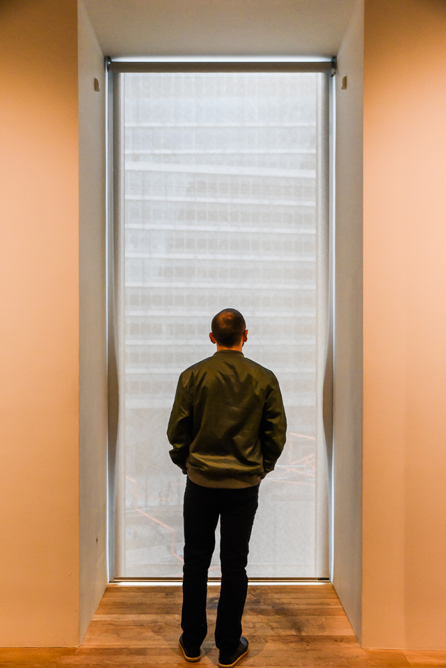 Man standing at window in Tate gallery, London