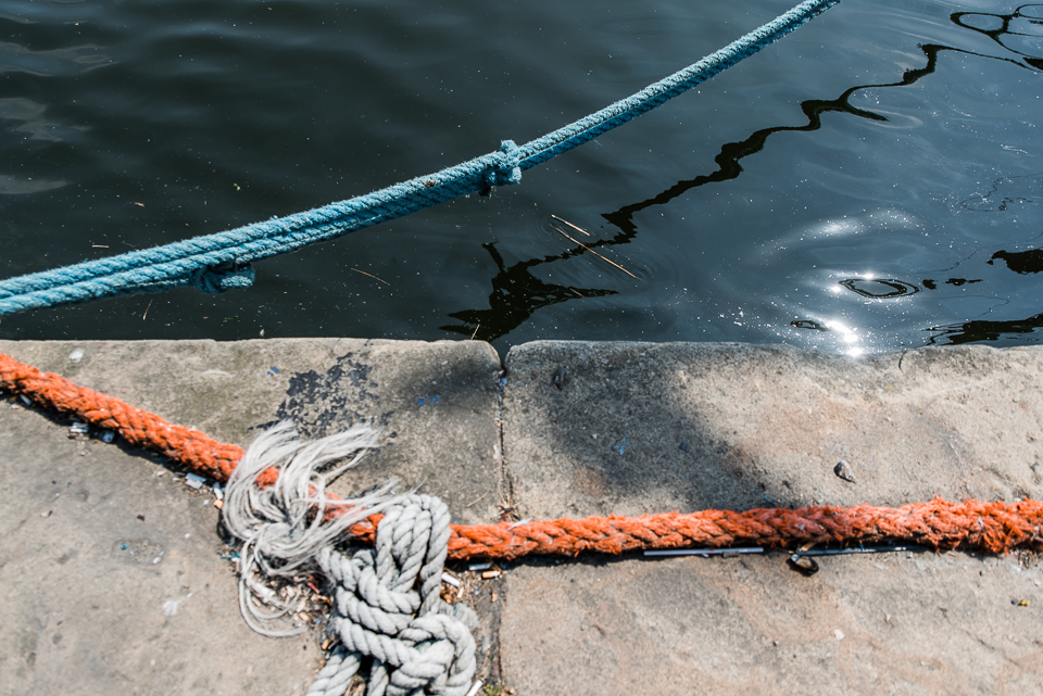 Light and ropes on Ipswich waterfront, blue, white and orange co