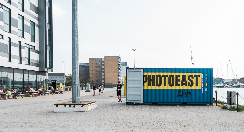 Photoeast blue and yellow container exhibition