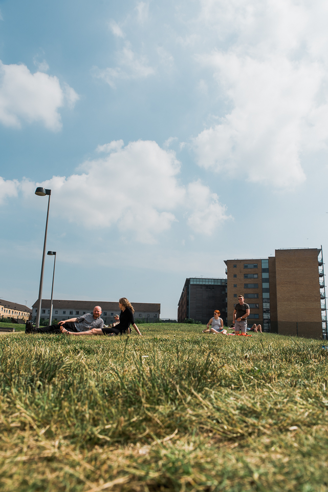 People chilling on the lawn on a sunny day by Ipswich waterfront