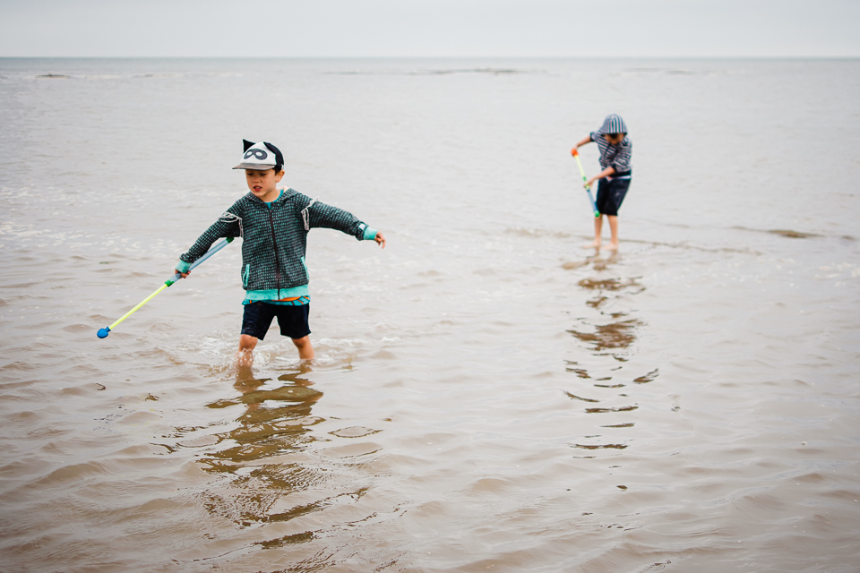 Children playing in the sea in North Norfolk
