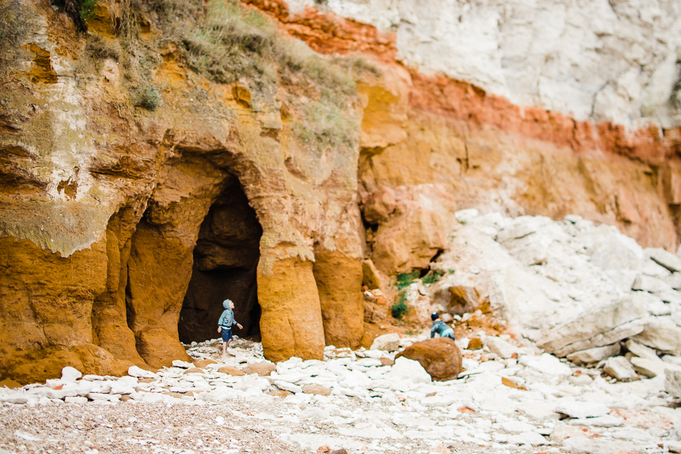 Children playing around the cliffs at Hunstanton beach