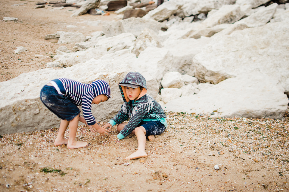 Two children playing by the cliffs at Hunstanton beach