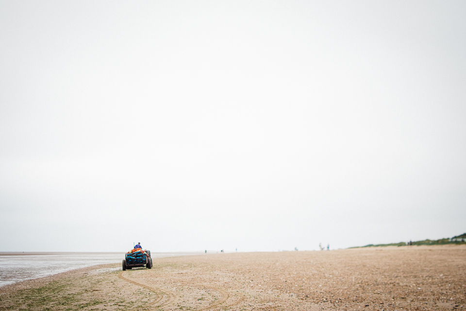 Blue tractor on Old Hunstanton beach