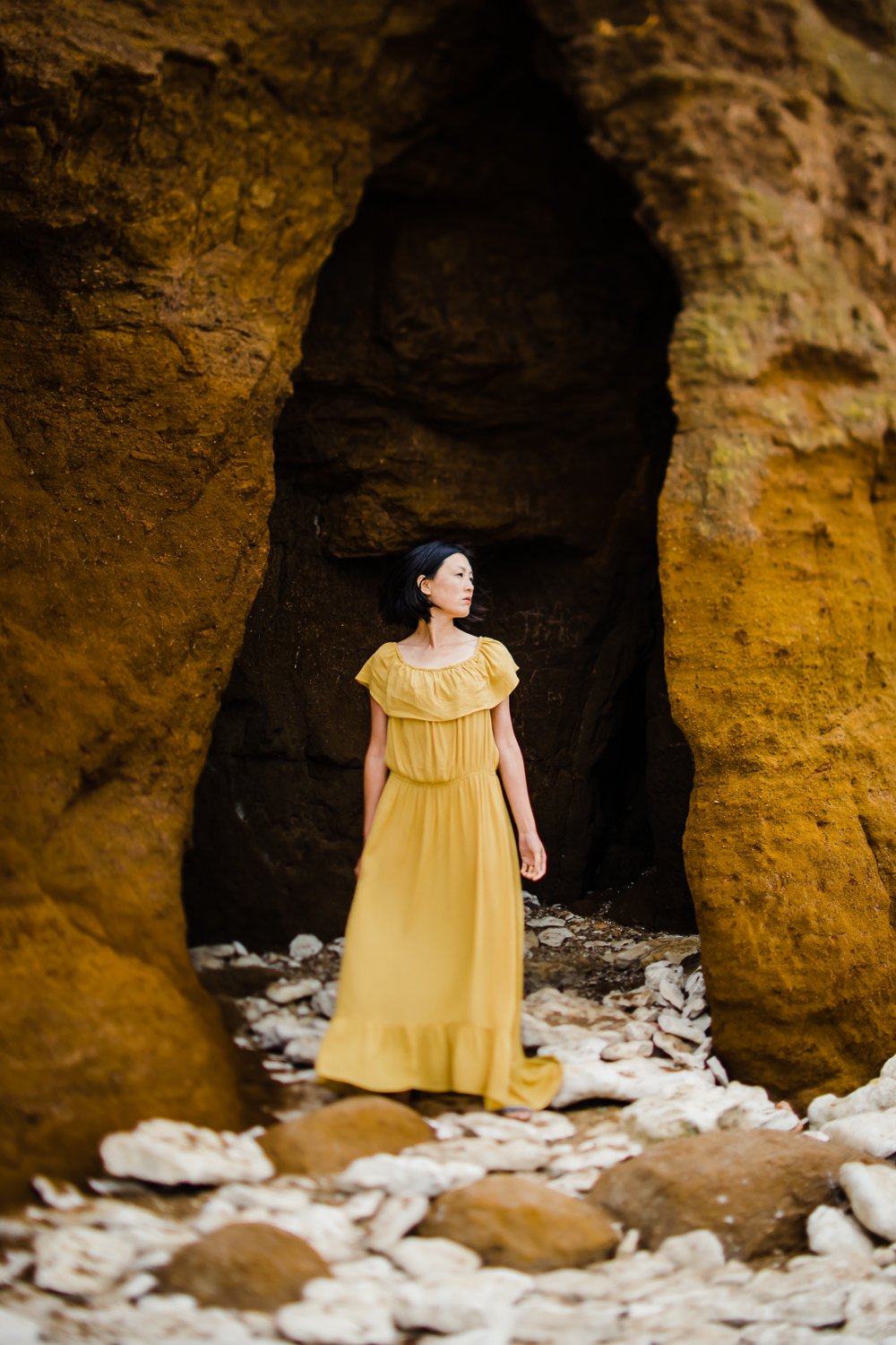 Colour portrait of Diana Hagues photographer in yellow dress at