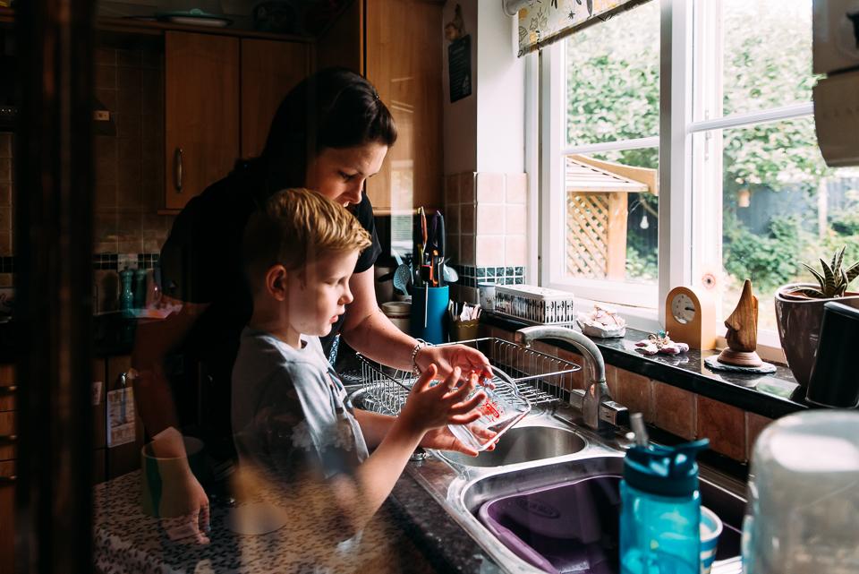 At the kitchen sink