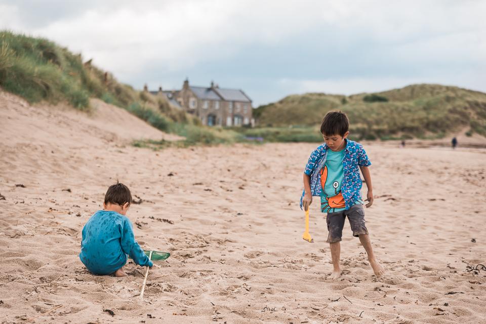 Boys playing on Bamburgh beach