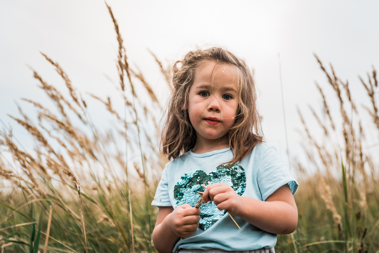 Portrait of a child with grass seeds in her hair