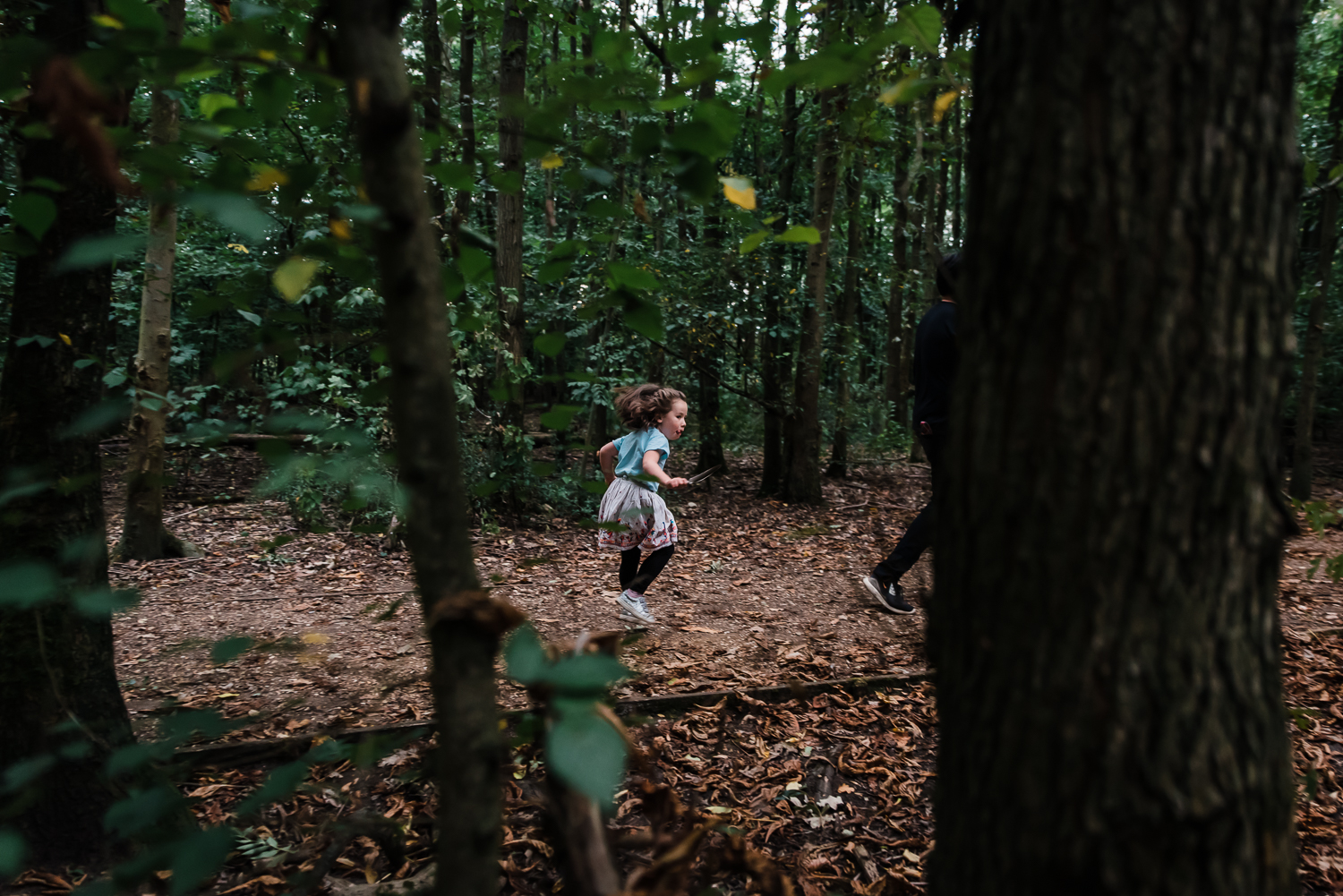 Child skips in the woods