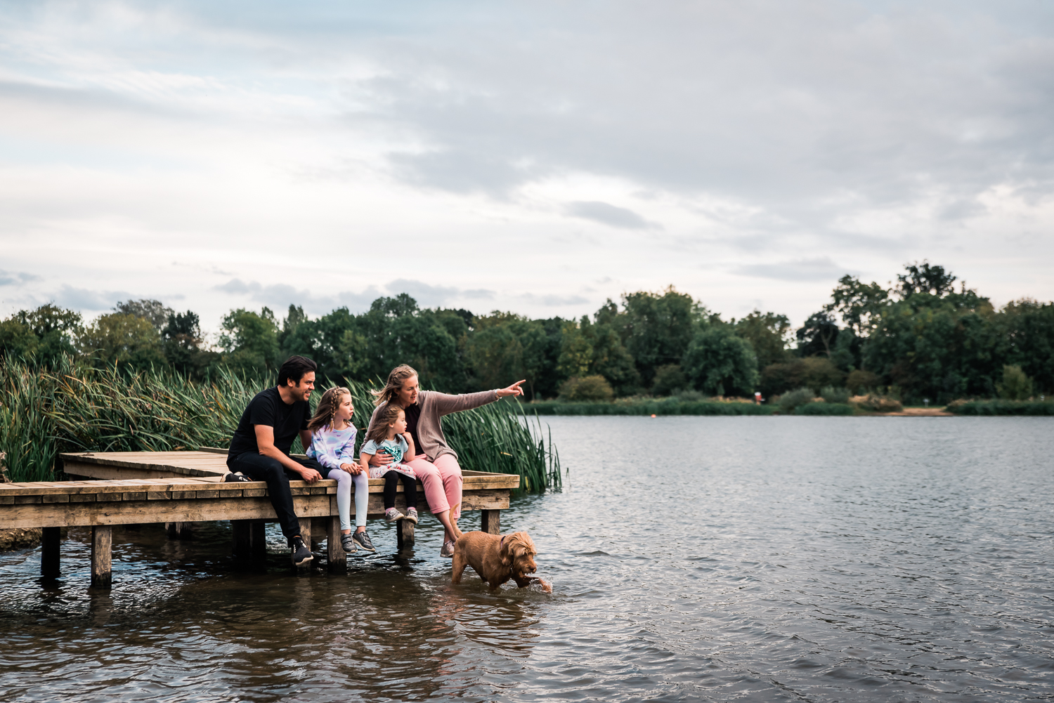 Natural family portrait by the a lake in Huntingdon