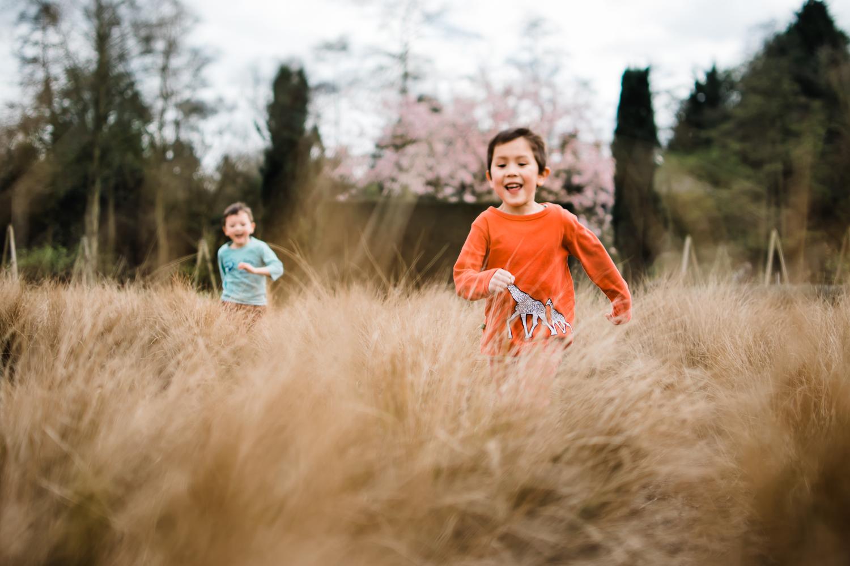 Children running through a grassy field