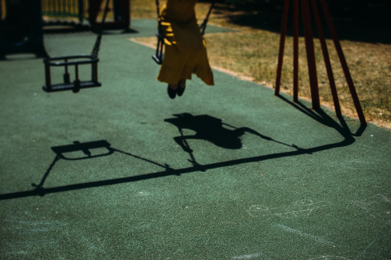 Model Sam Payne on play swing