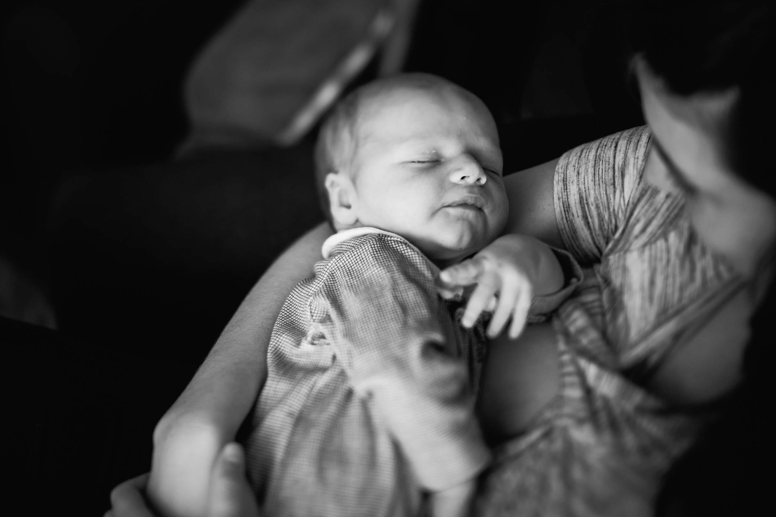 Freelensed photo of baby in mother's arms