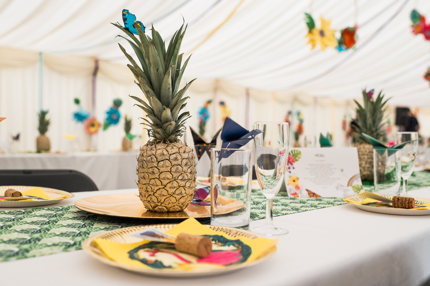 Pineapple table setting at a wedding in Cambridgeshire