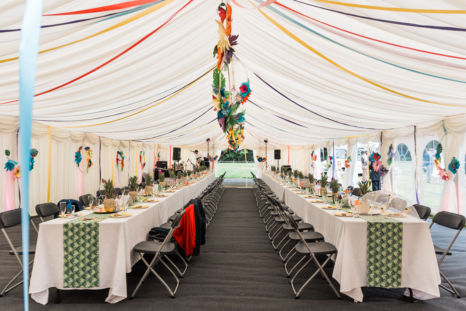Wedding table setting inside a marquee tent in Cambridgeshire