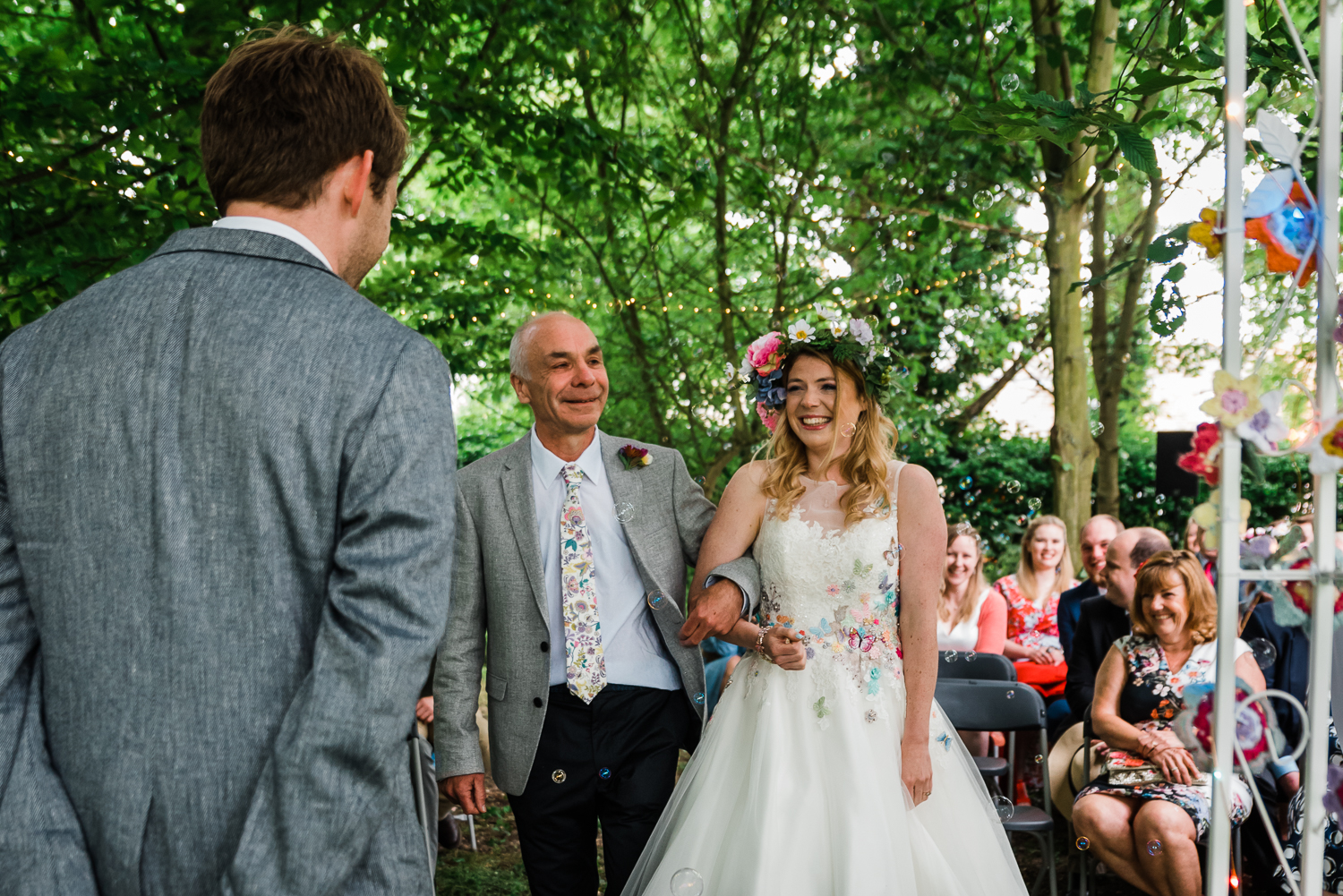Bride smiling at her husband at their woodland-themed wedding