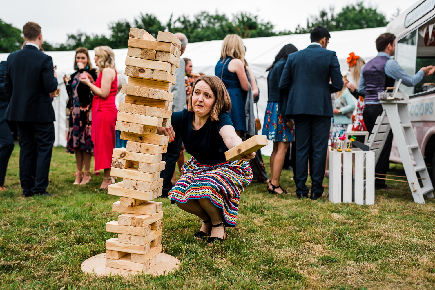 Garden games on the lawn at a festival-themed wedding