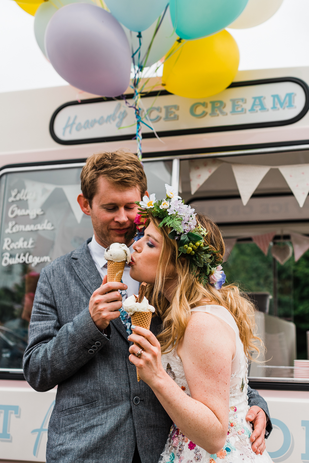 A wedding portrait of bride and groom sharing ice-cream together