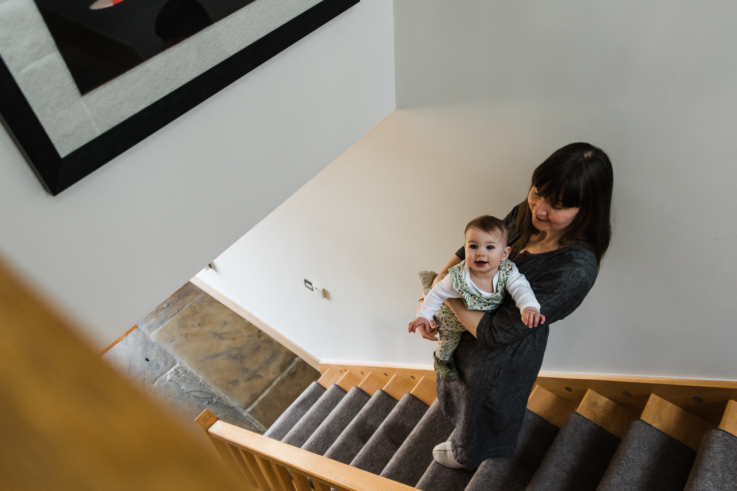 Mother and baby standing on the stairs
