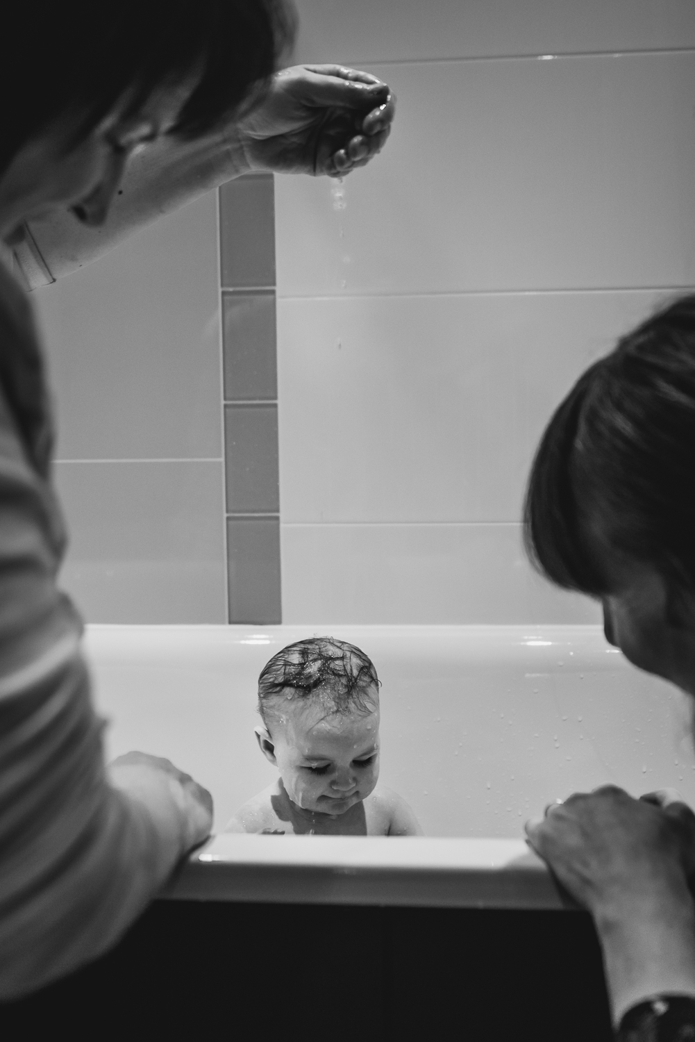 Bathtime routine captured during a documentary family photoshoot