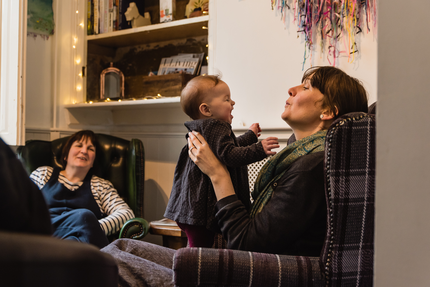A lesbian couple and their baby taken by Diana Hagues Photograph