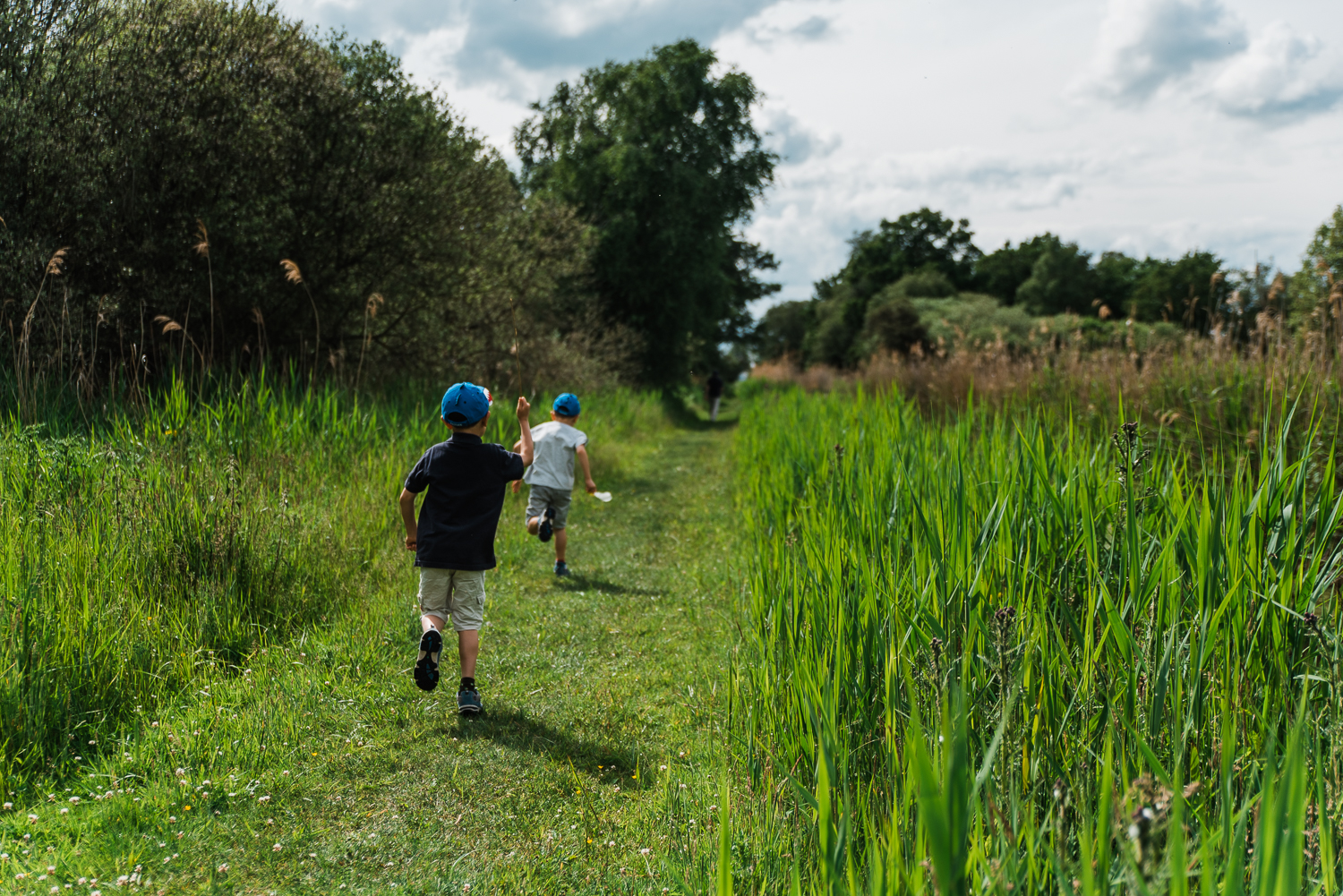Family out exploring Woodwalton Fen in the summer by Cambridgesh
