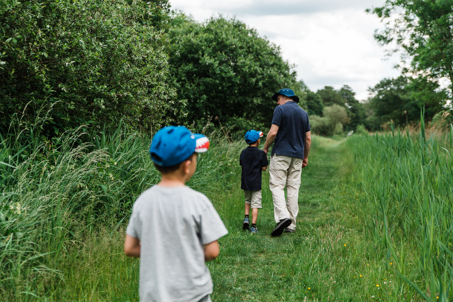Family out exploring Woodwalton Fen in the summer by Cambridgeshire photographer Diana Hagues