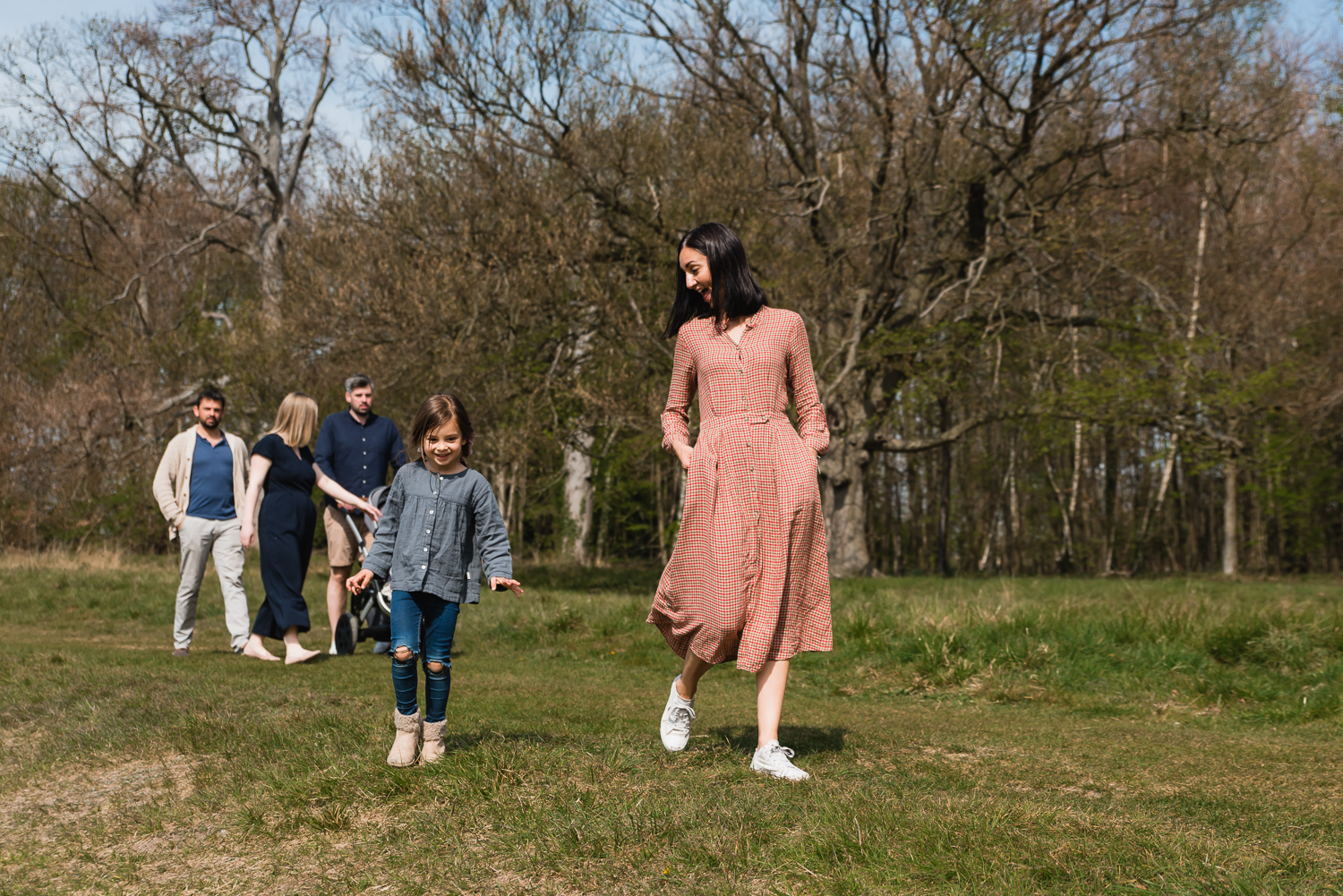 Mum and daughter taking a stroll together during a family photoshoot in Wandlebury Country Park