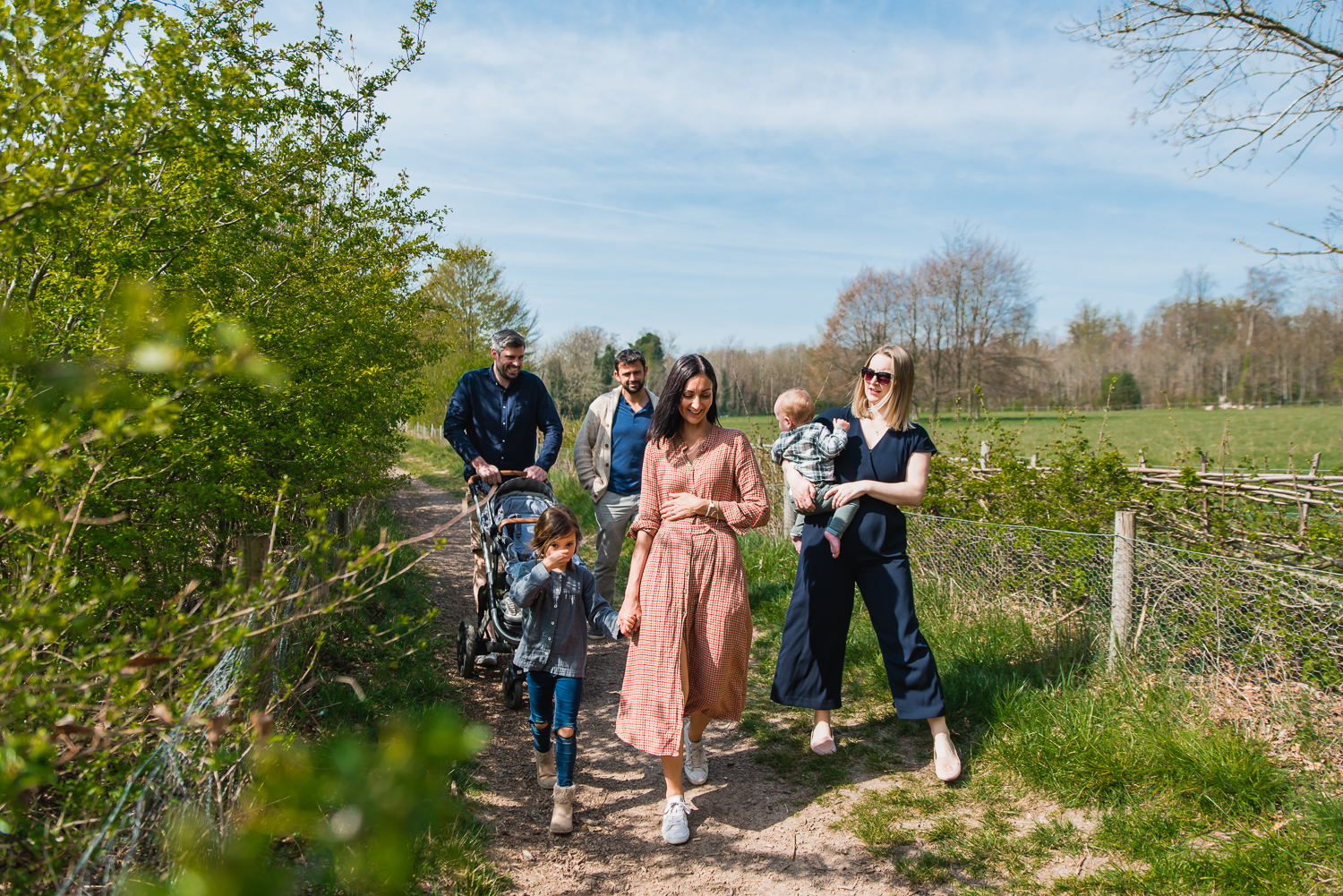 A large family party going on a country walk around Wandlebury Country Park in Cambridge