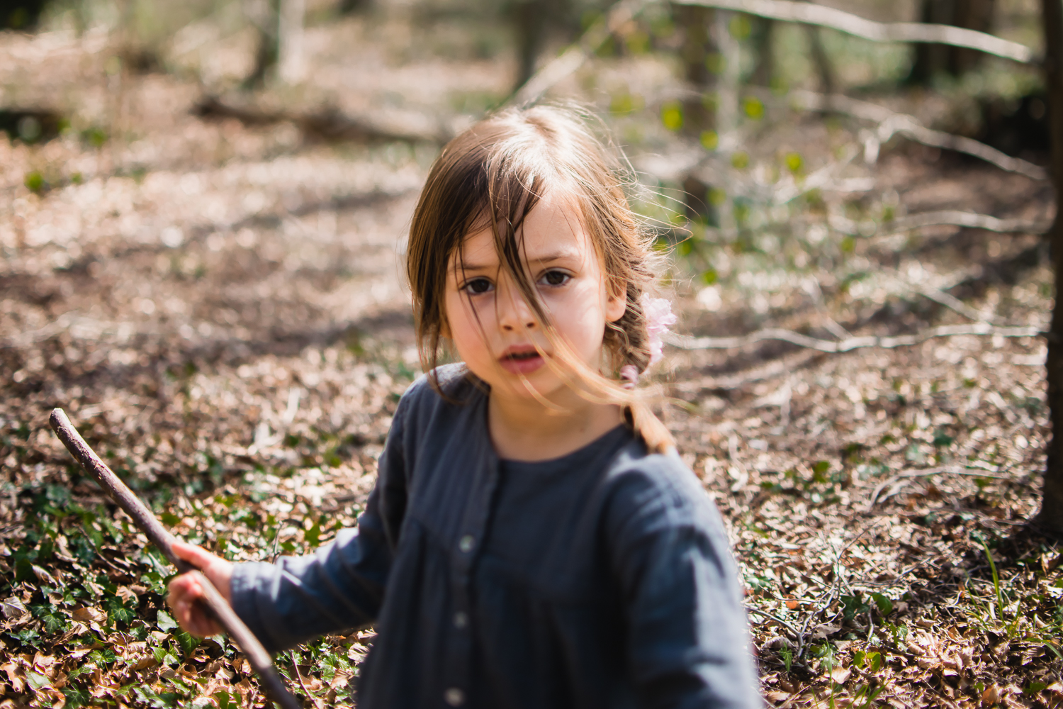 Freelensing photo of a little girl with hair blowing across her face