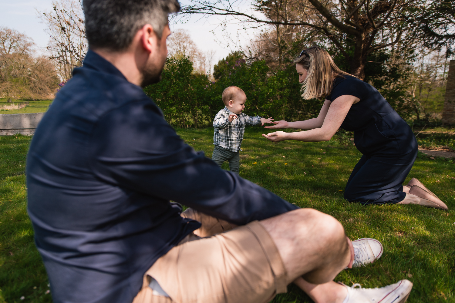 A baby learns to walk to his mother on a family photoshoot with Cambridge photographer Diana Hagues Photography