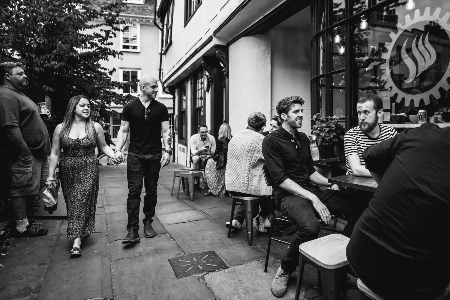Black and white photograph of a couple taking a walk down a Cambridge lane by Smokeworks