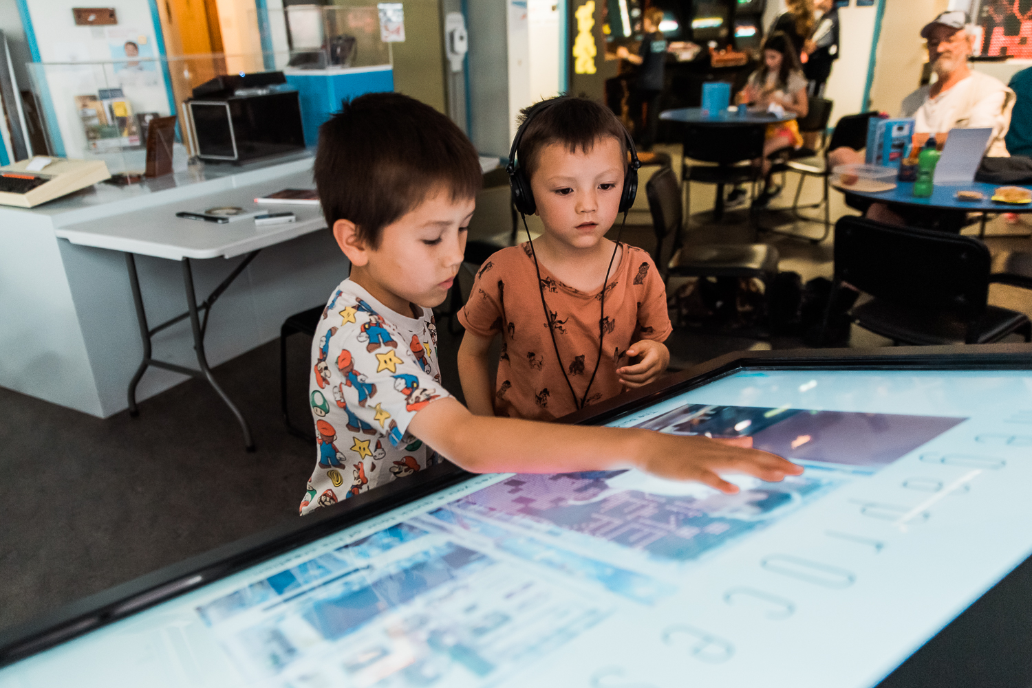 Two children working the touchscreen displays in the Museum of Computing History in Cambridge